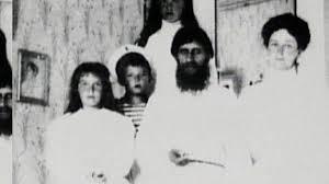 Alexandra and three of her children with Rasputin.
